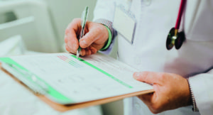 Doctor with a clipboard diagnosing legionnaires' disease