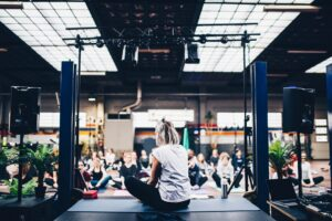 Woman delivering an event to people on yoga mats